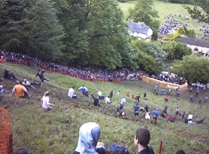 Cheese rolling! By Dave Farrance (Own work) [CC-BY-SA-3.0 (http://creativecommons.org/licenses/by-sa/3.0) or GFDL (http://www.gnu.org/copyleft/fdl.html)], via Wikimedia Commons