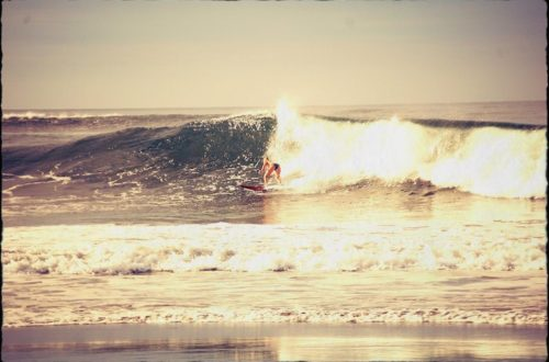 Candice Tomkins surfing