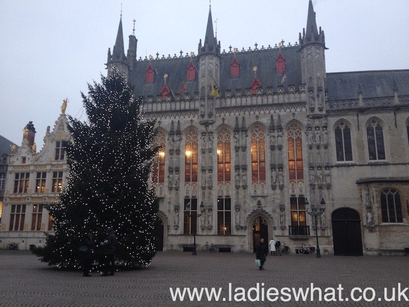 A beautiful Christmas tree in front of Bruges' town hall, in Burg.