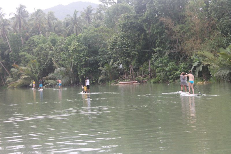 Stand-up paddleboarding along the Loboc river.