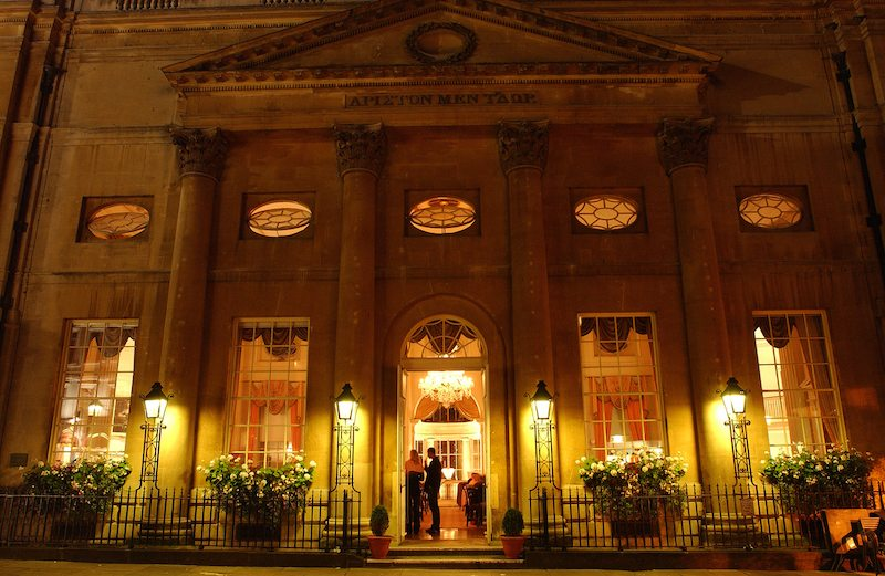 The Pump Room lit up at night.