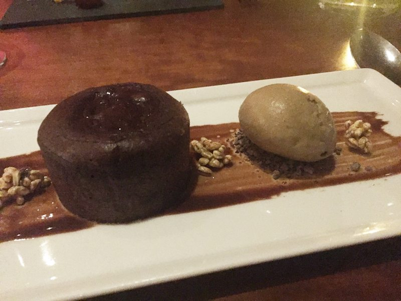 a bitter chocolate fondant with treacle and barley ice cream