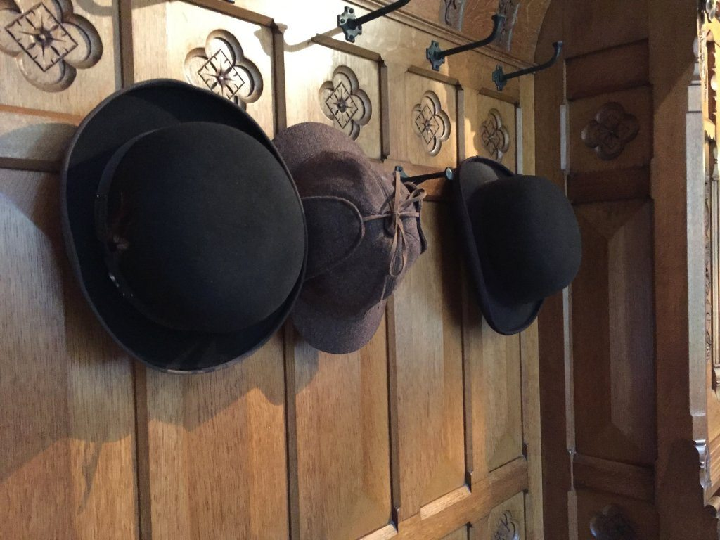 Sherlock and Watson's hats found hanging up in the hallway at Tyntesfield.
