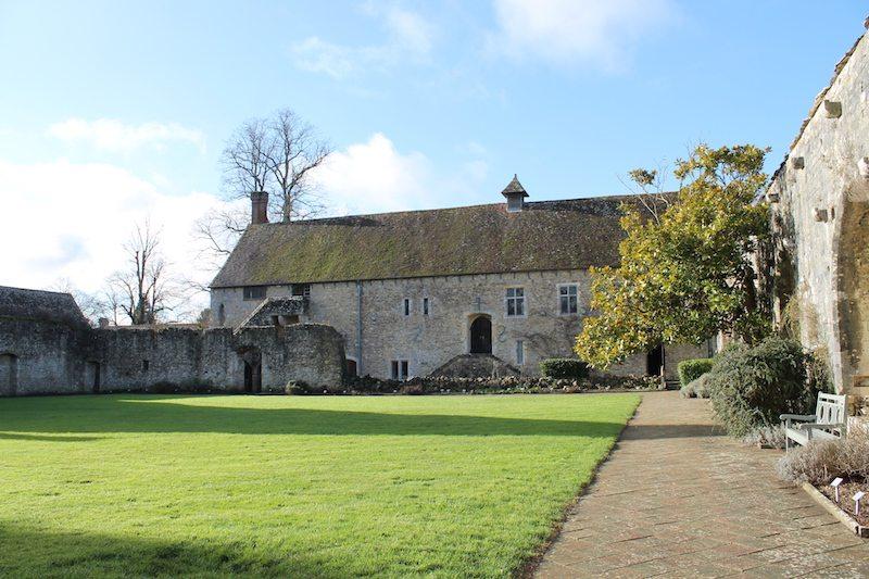 Exploring the beautiful cloisters of Beaulieu Abbey.