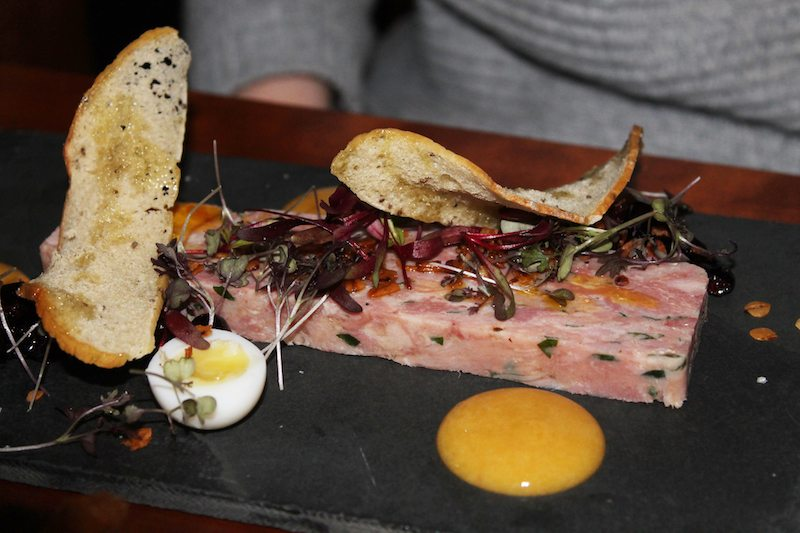 ham hock terrine with quail eggs and fennel croutes