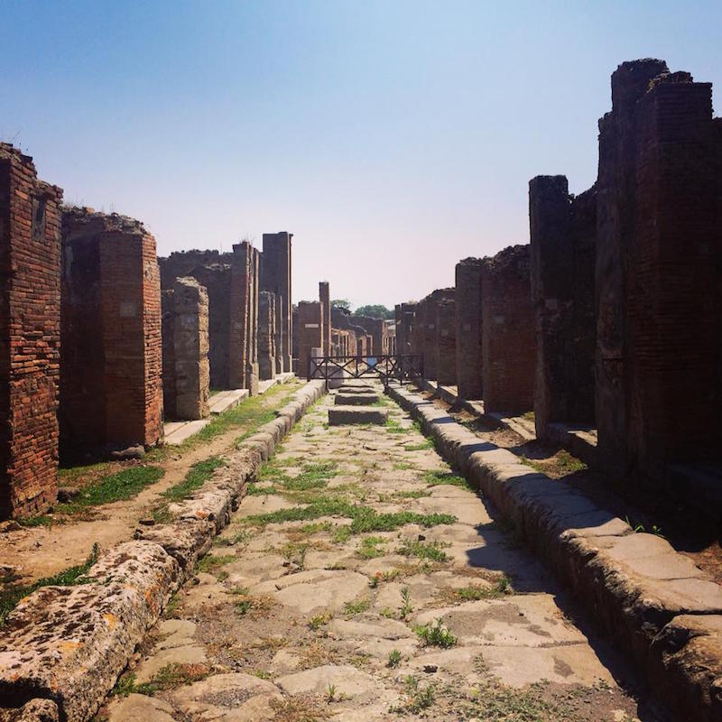 Looking down the remains of a roman street in Pompeii.