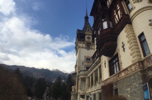 Peles Castle, overlooked by the Carpathian Mountains.