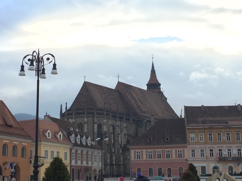 The Black Church looming over the Brasov Town Square.