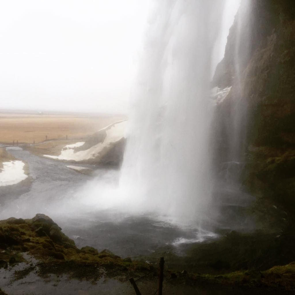 Behind a waterfall iceland