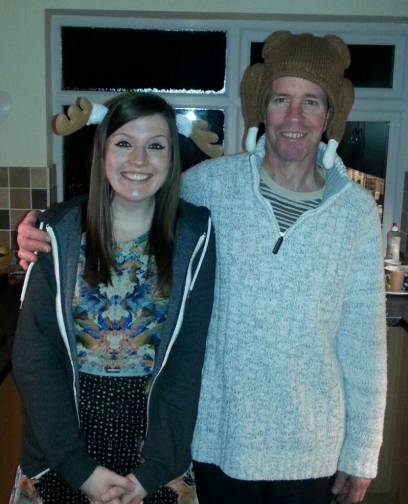 Laura and her dad with their festive headwear.