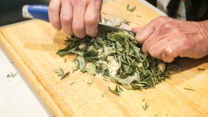 Chopping herbs at Tuscan Food Masterclass