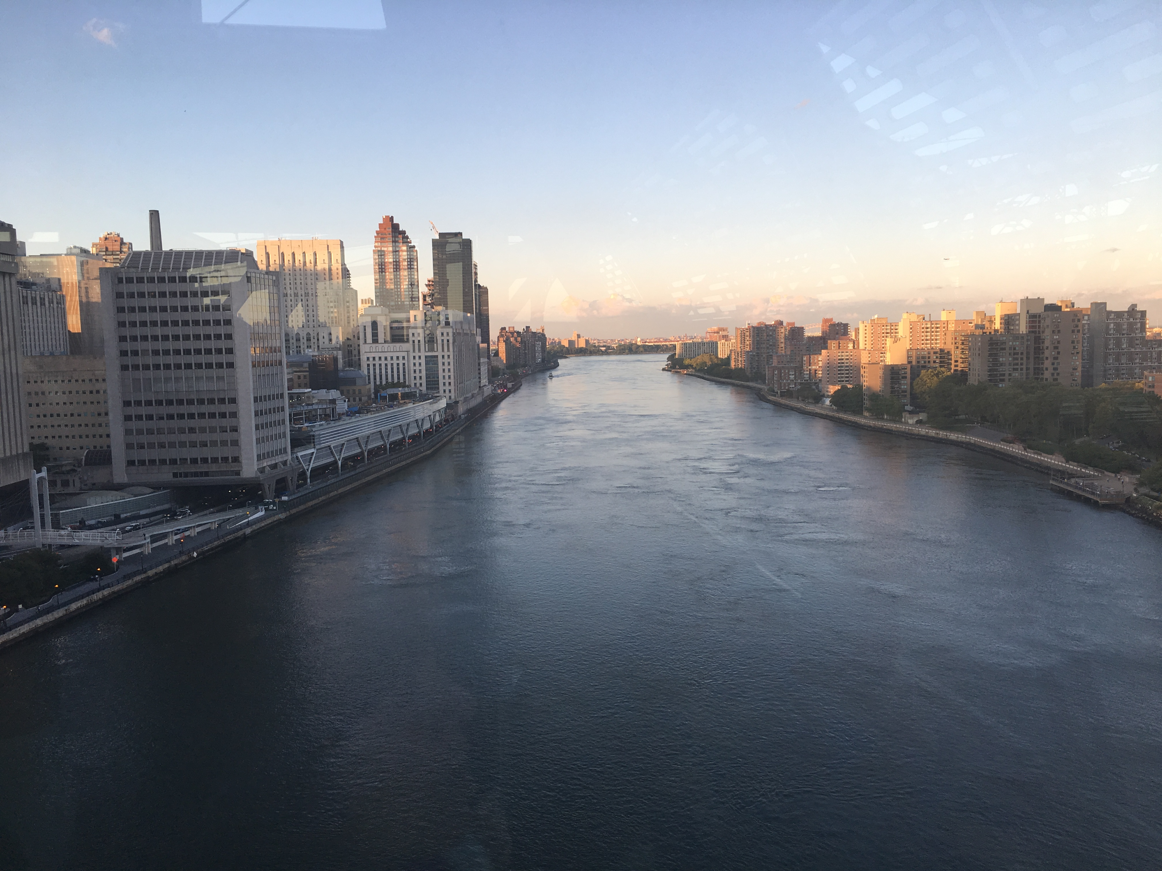 The beautiful East River from the center of the cable car line.