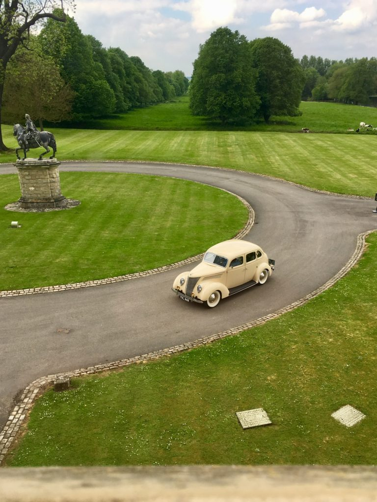 Old style car arriving at Hartwell House