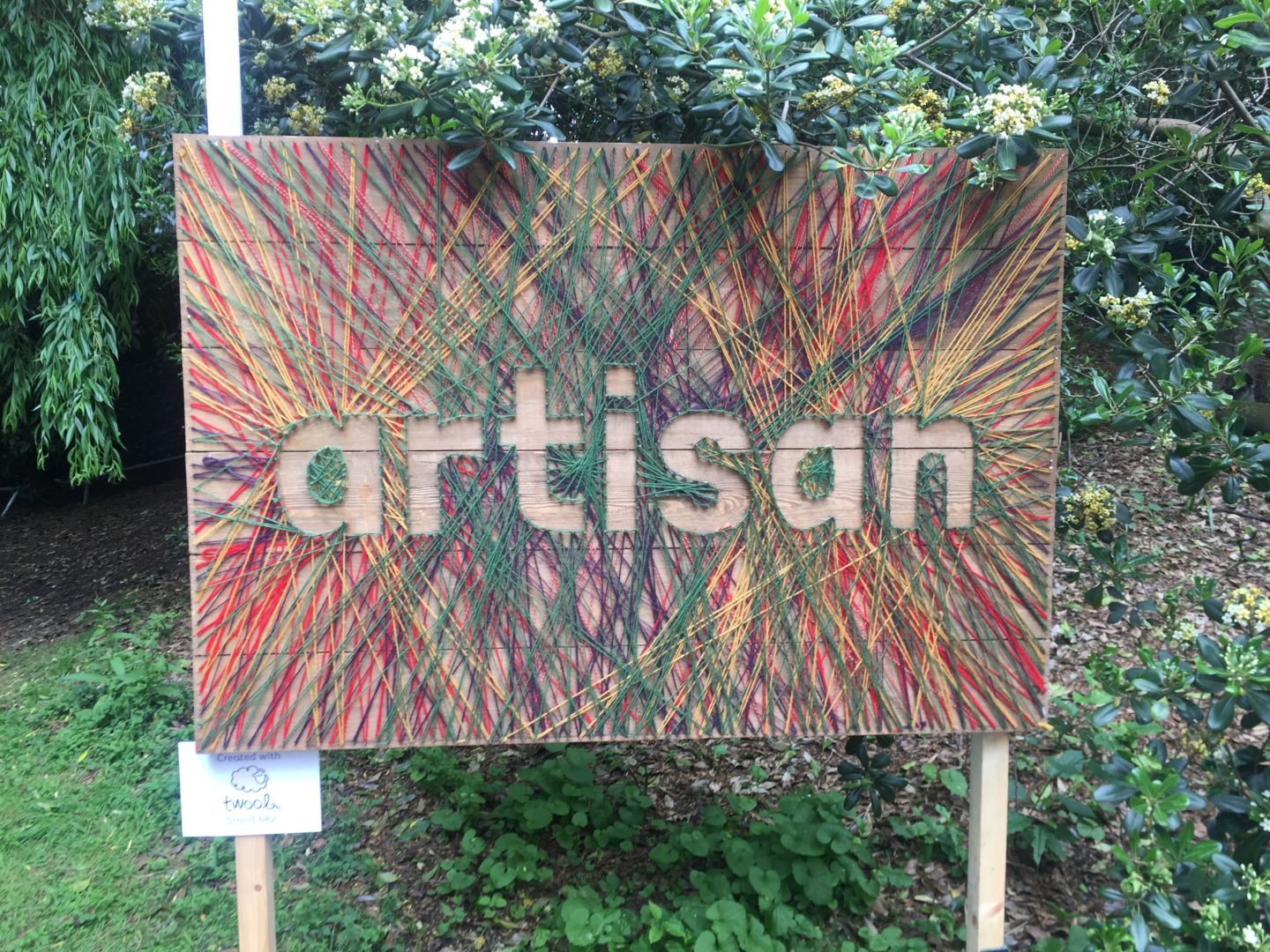 The Artisan Garden sign made from wool and nails.