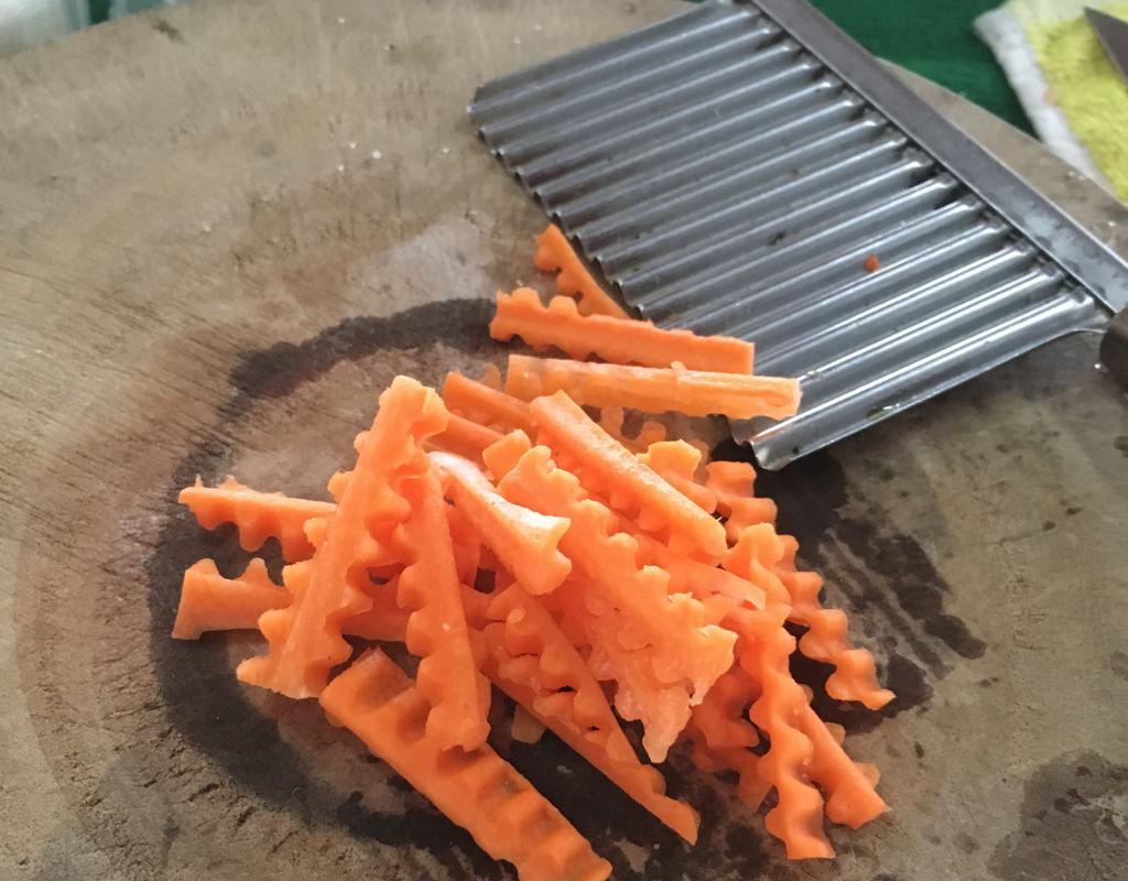 Cutting carrots for Bún gà