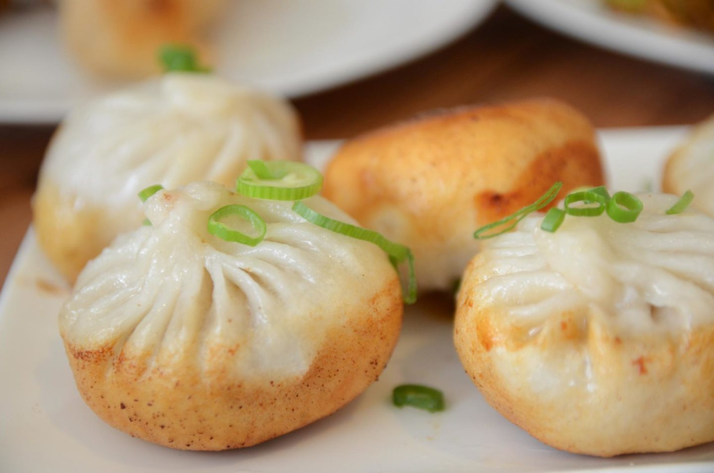 What to eat in Shanghai fried pork buns image credit Alpha, via Flickr